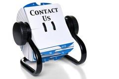 Éntrenos en contacto con en índice de tarjeta rotatorio Fotos de archivo libres de regalías