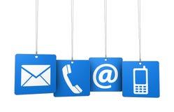 Éntrenos en contacto con los iconos del web en etiquetas azules Fotografía de archivo libre de regalías