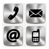 Éntrenos en contacto con los iconos en los botones metálicos Imágenes de archivo libres de regalías