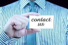 Éntrenos en contacto con - tarjeta de visita Imágenes de archivo libres de regalías