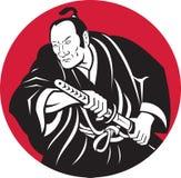 Épée japonaise de retrait de guerrier de samouraï Photographie stock libre de droits