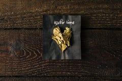 Épice de chaux de Kaffir avec le nom écrit sur le papier Photos libres de droits