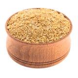 Épices de coriandre dans une cuvette en bois Images libres de droits