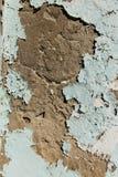 Épluchage de la peinture bleue sur le plâtre Image stock