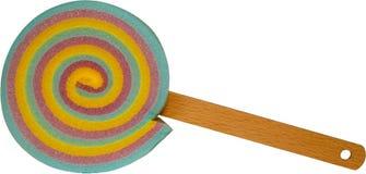 Éponge colorée de gâteau de lucette avec la poignée en bois de bâton - mélangée Photo stock