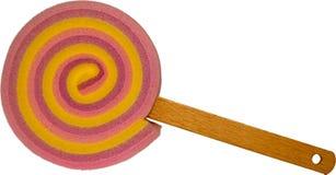 Éponge colorée de gâteau de lucette avec la poignée en bois de bâton - rose mélangé de couleurs en pastel Photos stock