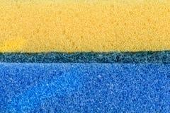 Éponge de mousse de texture Jaune et bleu Images libres de droits