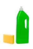 Éponge jaune et bouteille verte avec du savon de paraboloïde photos stock