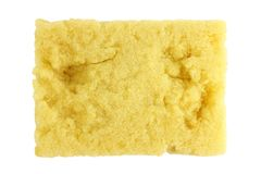 Éponge, vieux lavage d'éponge, éponge de lavage de plat, nettoyage jaune absorbant d'éponges d'isolement sur le fond blanc, épong Photos libres de droits