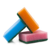 Éponges brillamment colorées sur le fond blanc Image libre de droits