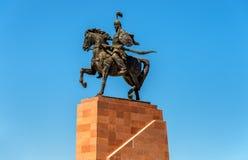 Épopée de monument de Manas sur la place d'aile du nez-Trop à Bichkek, Kirghizistan photographie stock libre de droits
