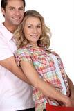 Épouse dans des bras de maris Image stock
