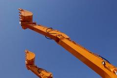 Épuisette d'excavatrice en ciel Photo stock
