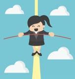 Équilibrage de femme d'affaires Photo stock
