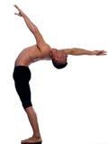Équilibre gymnastique d'acrobaties de verticale d'homme Images libres de droits