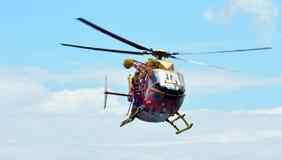 Équipage d'hélicoptère de délivrance de Westpac dans la mission de sauvetage Photographie stock libre de droits