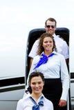 Équipage des aéronefs sortant l'avion Photographie stock libre de droits