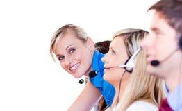 Équipe à un centre d'attention téléphonique Photo libre de droits