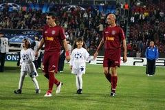 Équipe CFR Cluj entrant dans la zone Photos stock