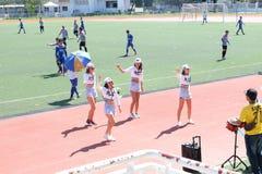 Équipe Cheerleading de société Photo stock