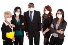 Équipe d'affaires avec des masques de grippe photos stock
