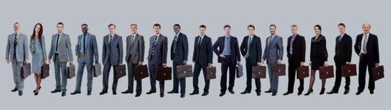 Équipe d'affaires avec leur serviette dans une ligne simple contre le wh Photo stock