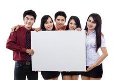 Équipe d'affaires et panneau-réclame blanc Photo stock