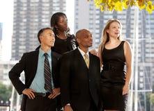 Équipe d'affaires regardant au côté Photos stock