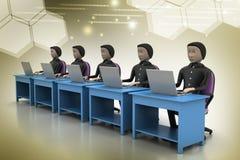 Équipe d'affaires regardant un ordinateur portable Photo stock