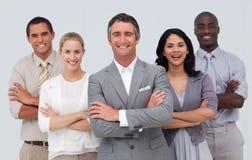 Équipe d'affaires restant sur le fond blanc Photo stock