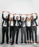 Équipe d'affaires tenant la corde forte Images stock