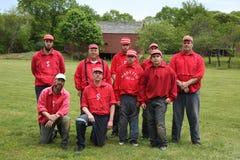 Équipe de baseball dans l'uniforme du 19ème siècle de vintage pendant le jeu de boule de base de style ancien après les règles et Photo libre de droits