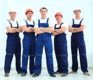 Équipe de constructeurs professionnels dans les casques Images stock