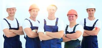 Équipe de constructeurs professionnels dans les casques Photos libres de droits