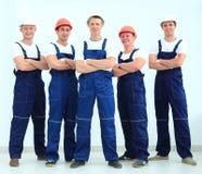Équipe de constructeurs professionnels dans les casques Image stock