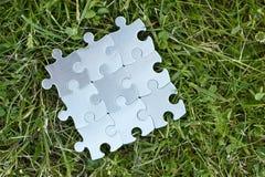 Équipe de partie de puzzle fonctionnant bien ensemble Photos stock
