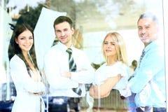 Équipe de sourire heureuse d'affaires Photographie stock libre de droits
