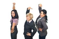 Équipe des femmes d'affaires étirant des mains Images stock