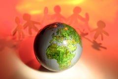 Équipe et globe Image libre de droits