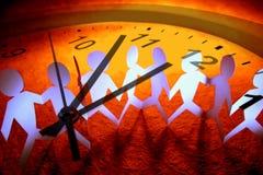 Équipe et horloge Photo stock