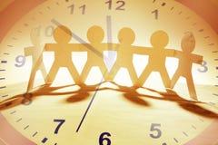 Équipe et temps Image stock