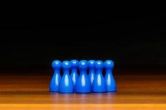 Équipe, groupe, amis, bleu et noir de concept Photographie stock libre de droits