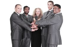 Équipe internationale d'affaires montrant l'unité avec leur toge de mains Photo libre de droits