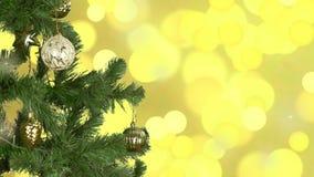 Équipe la main décorent l'arbre de Noël lumières d'or de fond Cercle jaune de boule de sphère Clignotement d'éclat de lueur d'éti banque de vidéos
