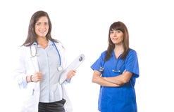 Équipe médicale féminine d'isolement sur le blanc photos libres de droits