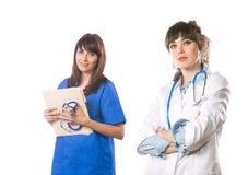 Équipe médicale féminine d'isolement sur le blanc photo libre de droits