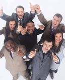 Équipe multiculturelle d'affaires avec des pouces  Photographie stock