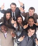 Équipe multiculturelle d'affaires avec des pouces  Photos stock