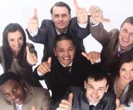 Équipe multiculturelle d'affaires avec des pouces  Images stock