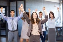 Équipe réussie d'affaires célébrant leur victoire Images stock